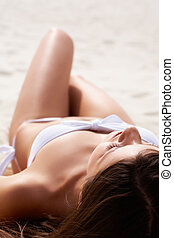 Sunbathing female - Image of female in white bikini...