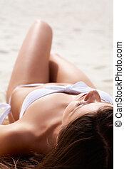 Sunbathing female - Image of female in white bikini...