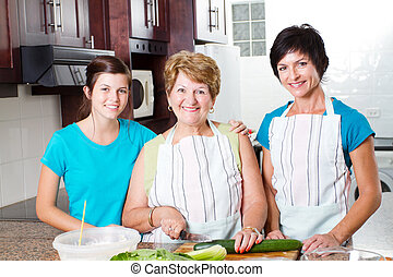 grandmother cooking with her daughter and granddaughter