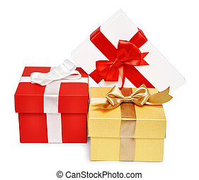 Holiday gift boxes decorated with ribbon isolated on white...