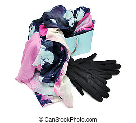 Scarf with black gloves in shopping bag isolated on a white...