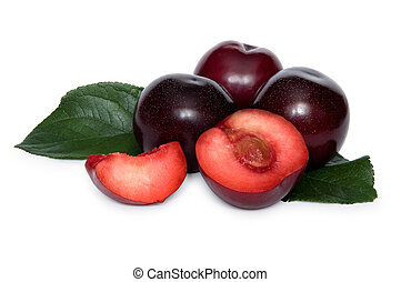 Some plums with two slices of plum over white background