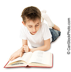 Boy Reading Book - The boy lying on the floor and reading a...