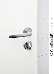 door knob - Aluminium door knob on the white door