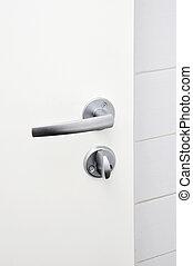 door knob - Aluminium door knob on the white door