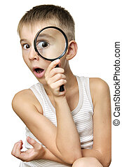 Surprised boy with magnifying glass - Surprised boy looking...