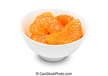 peeled grapefruit slices in white bowl isolated on a white...