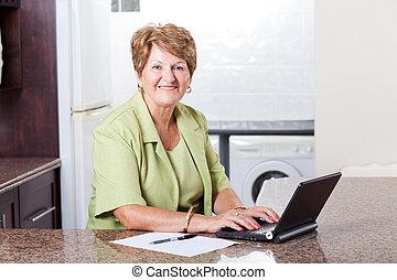 modern senior woman using laptop