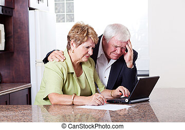 senior couple worrying about their money situation
