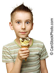 boy with ice cream - Surprised boy with ice cream in his...