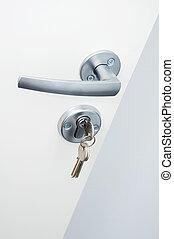 door with key in lock - Opened office white door with door...