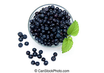 Blueberries - Fresh Blueberries in bowl isolated on a white...