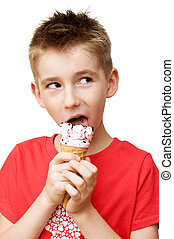 boy eating ice cream - Eighth year boy eating ice cream...