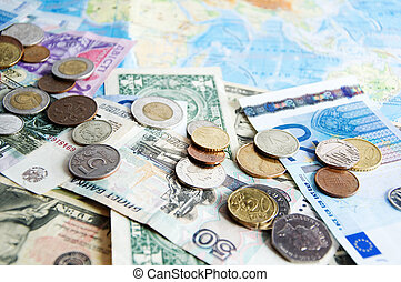 Traveling Expenses - Coins and bills of different countries...