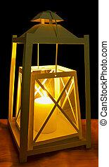 Lantern - A decorative white lantern with a lit candle