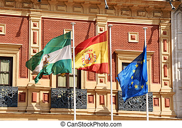 Flags at Palace of San Telmo, Seville - Flags of Andalusia,...