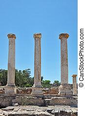 Three columns on the excavation of a Roman amphitheater