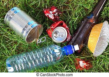 Litter on grass - Photo of litter on grass, bottles, cans...
