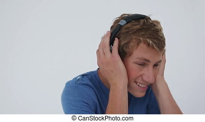 Smiling man wearing headphones against a white background
