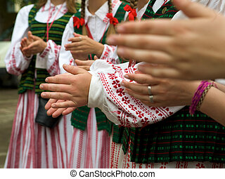 Women dressed in traditional clothes Lithuanian