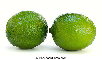 Two limes isolated on the white background