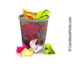 paper in waste basket - colored paper in waste basket on...