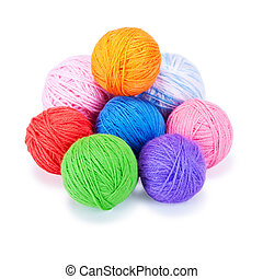 Several multi-colored woolen balls on a white background