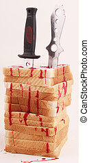 toast - Slices of bread as tower with knives and traces of...