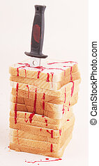toast - Slices of bread as tower with a knife and traces of...