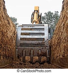 excavator - Excavator digging a deep trench