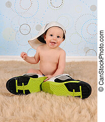 sweet baby boy wearing his Daddys hat and sneakers - sweet...