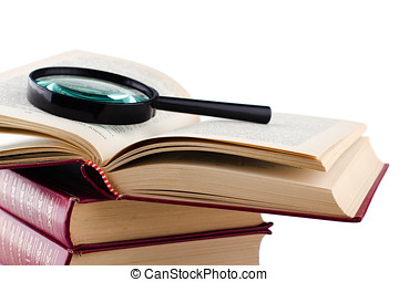 Open old book with a loupe on white background. Isolated.