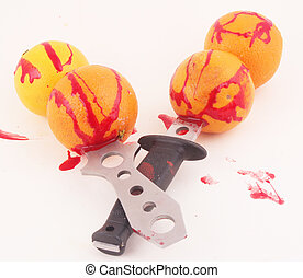 oranges - Oranges with knives and traces of blood