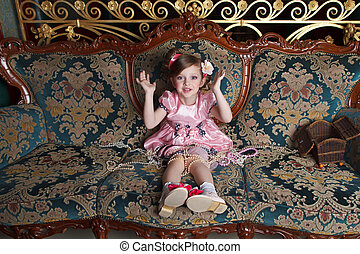 Girl in pink - A girl plays with her %u200B%u200Bmother's...