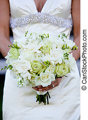 Bridal bouquet - a bride holding a green and white wedding...