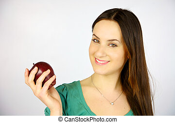 young girl smiling with red apple
