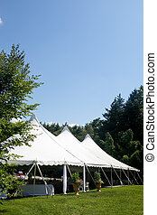 wedding tent - A large white wedding tent set up for an...