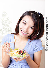 Young Girl Happy Eat salad at home