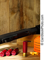 12 Gauge Shotgun, Shells, and Clay Pigeons - Black 12 gauge...