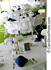 Wedding tables with blue napkins
