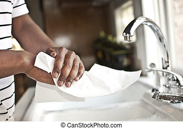 Hands Drying On A Paper cloth - A person dries his hands