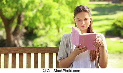 Close-up of a woman reading a book