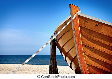 Bow - Front view of a wooden fishing boat, sea in background...