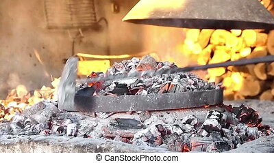 Preparing traditional meal dalmatian Peka on open fireplace