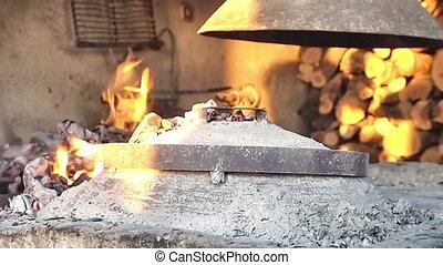 Man preparing fireplace