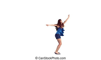 Woman dancing with her arms out in slow motion against a...