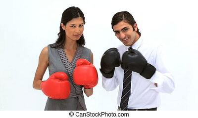 Smiling friends using boxing gloves