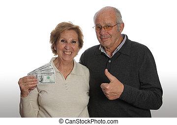Elderly couple with money