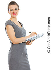 Student woman writing in notepad