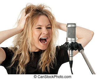 Rock singer screaming to the microphone - Female rock singer...